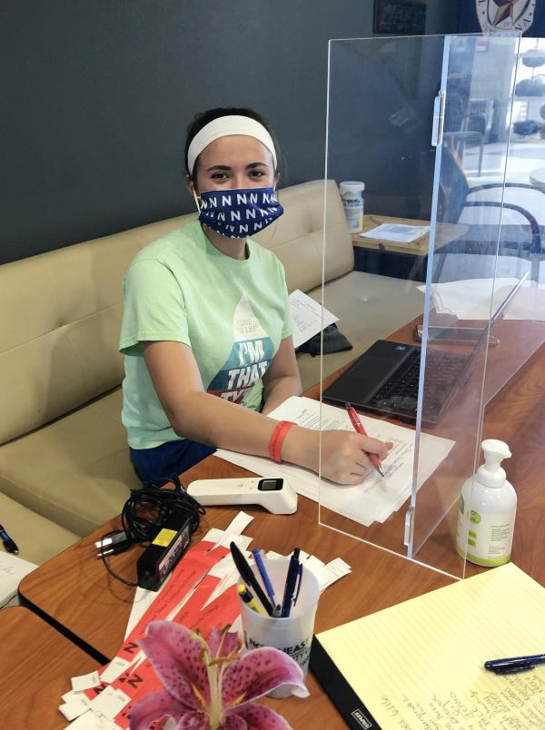 Work4College student, Elena Dodd, works at NTCC's wellness check station in the University Health Science (UHS) building.