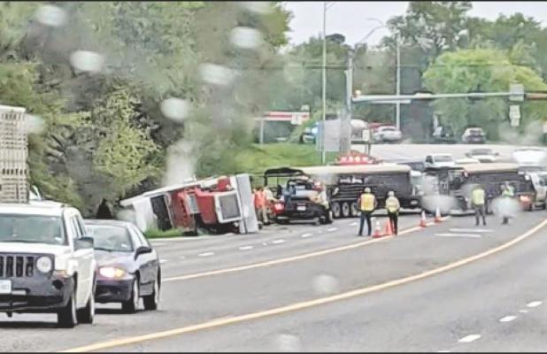 Peterbilt tractor-trailer overturns on Hwy. 271