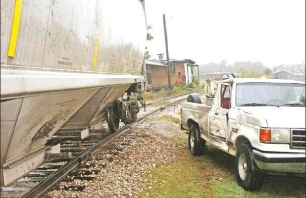 Train collides with truck on tracks