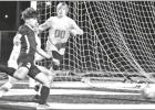 Junior #3-Victor Benites goes for a goal against Chapel Hill The Pirates defeated Chapel Hill, Feb.28, 4-0. GAZETTE PHOTOS / ELLIS KNOX