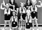 COURTESY PHOTO Pittsburg Youth Football Association Cheerleaders won 1st place at the Tri-county cheer competition on November 2nd. Names starting on back row left to right . Coach Cassi Moss , Coach Maria Crompton. Middle row, Madilyn Moss ,Marysa Fowler